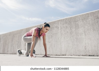 a stubborn young girl runner in a pink T-shirt prepared to escape a long marathon outdoors
