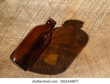 Stubby beer bottle on weathered wood