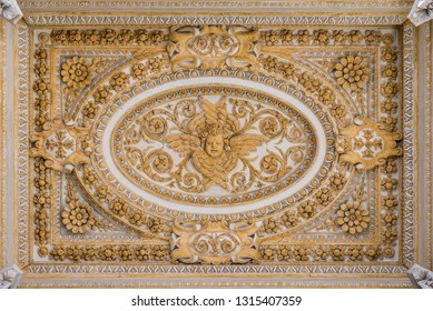 Stucco decoration in the ceiling of the portico in Saint Peter Basilica in Rome, Italy. February-16-2018