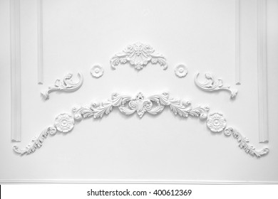 Stucco elements on white wall