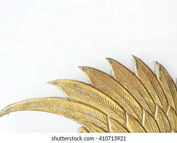 Stucco gold brass wing