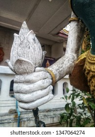 Stucco of unopened lotus flower or water lily flower in a hand. It is usually used for worship bhudda in Thai culture.
