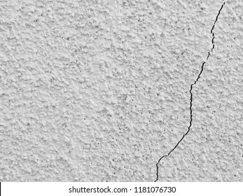Stucco wall with crack fissure, vintage 1940s exterior wall surface, rough texture background suitable for home renovations, construction, housing industries, grunge concept closeup with text space