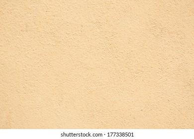 Stucco Wall - Orange Yellow stucco textured wall.
