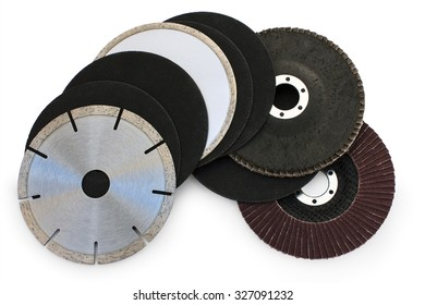 studded diamond blade and red color abrasive flap grinding disc number 120 and black abrasive vulcanite discs, number 140 on white background isolated