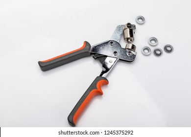 Studded metal rivets. Riveter manual on a white background