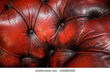 A studded red leather chairbackground.