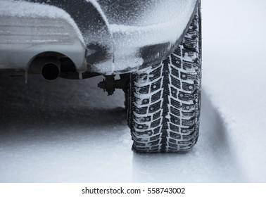 Studded snow tires in the snow.
