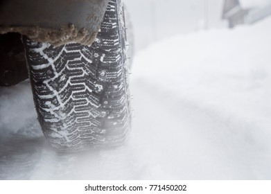 studded tires in the snow on the background of winter
