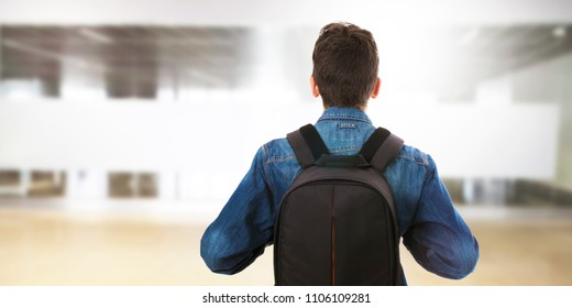 student with backpack at college or university