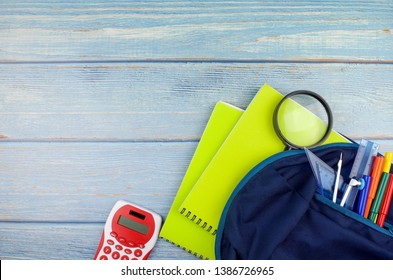 Student backpack and various school supplies, studing, education and back to school concept.