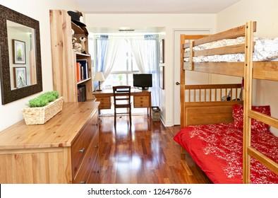 Student bedroom with hardwood floor and bunk beds - artwork is from photographer portfolio