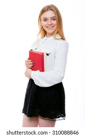 Student blond girl with books in white blouse and black skirt isolated on white background