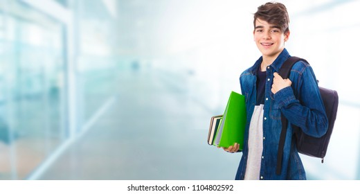 student with books and backpack at college or university