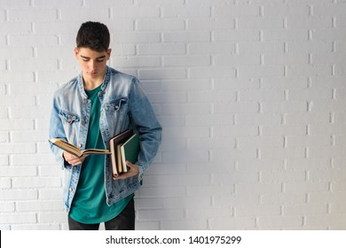 student with books in college or university