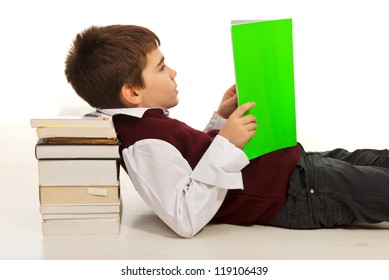 Student boy resting head on stack of books and reading
