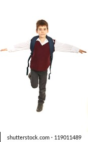 Student boy trying to keep balance and staning in one leg  with hands outstretched isolated on white background