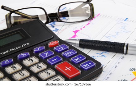 student, business workplace with calculator, pen, glasses and diagrams