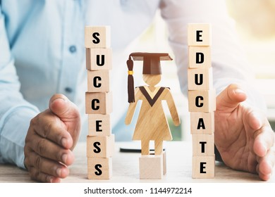 Student or businessman use hands protecting balance educate and success letter wooden blocks with Sign wood Graduation celebrating cap. Ideas for abroad international Educational and Back to School