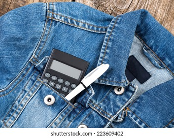 student calculator and pen in jeans jacket pocket