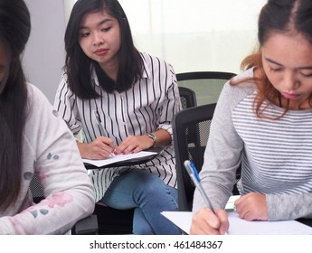 A student is cheating in an examination
