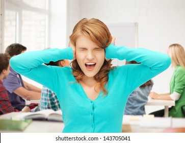 student closing her ears and screaming at school