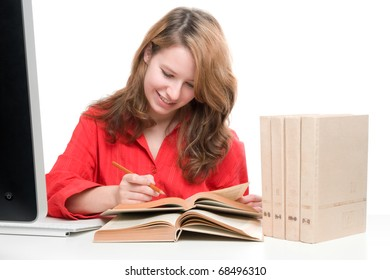 Student with computer and books - e-learning concept