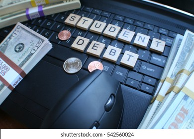 Student Debt With Block Letters On Keyboard with Stacks of Money