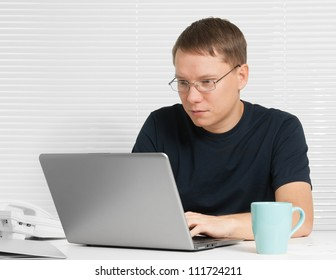 student at desk with laptop