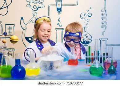 student doing research with chemical fluid in the laboratory