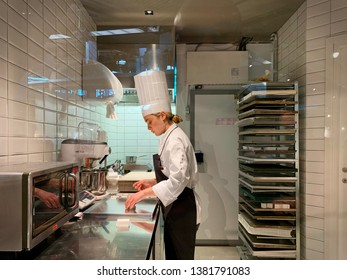 Student girl in cooking training cours. Turin, Italy- April 2019
