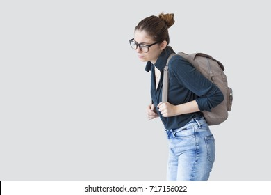 Student girl with heavy schoolbag