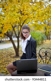 student girl with laptop outdoors