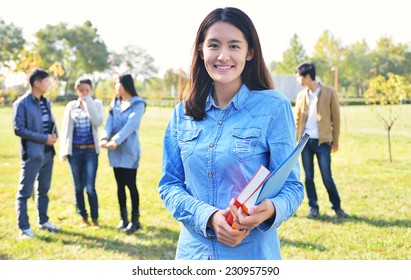 Student girl portrait  outdoor in park smiling happy going back to school