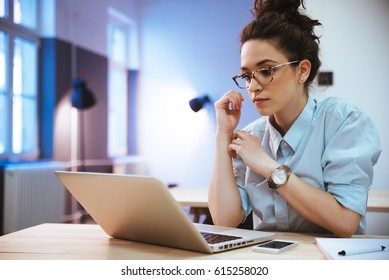Student girl reading a presentation on laptop
