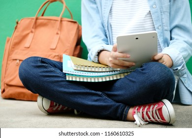 Student girl sitting and using digital tablet, online education, adult learning concept
