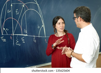 Student girl talking with professor