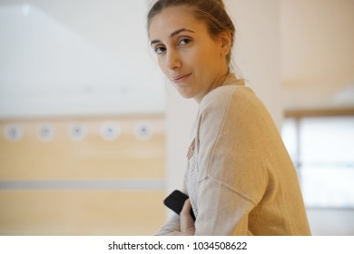 Student girl waiting in school corridor