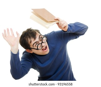 Student in glasses with a book over his head on white background