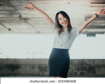 student and gradutation concept from asian beautiful girl(20s to 30s) with long black hair smile , lively, fresh and happiness feeling with asia car park background