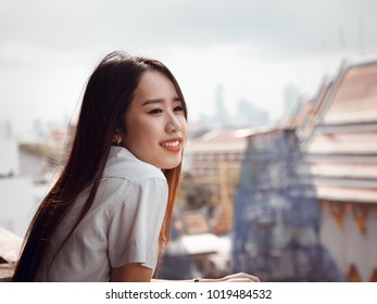 student and gradutation concept from asian beautiful girl(20s to 30s) with long black hair smile and happiness feeling with asia architecture background