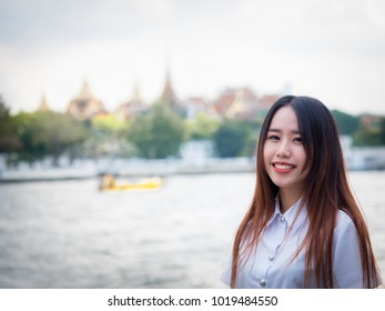 student and gradutation concept from asian beautiful girl(20s to 30s) with long black hair smile and happiness feeling with river background