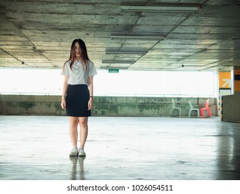 student and gradutation concept from asian beautiful girl (20s to 30s)with long black hair smile and in car park