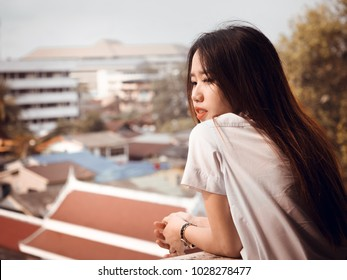 student and gradutation concept from asian beautiful girl (20s to 30s)with long black hair smile and happiness feeling with asia architecture background