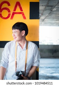 student and gradutation concept from asian boy(20s to 30s) with short black hair smile, good attitude and happiness feeling with asia architecture background