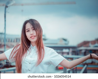 student and gradutation concept from portrait of asian beautiful girl(20s to 30s) with long black hair smile and happiness feeling with port background