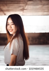 student and gradutation concept from portrait face of asian beautiful girl(20s to 30s) with long black hair smile and happiness feeling with asia architecture background