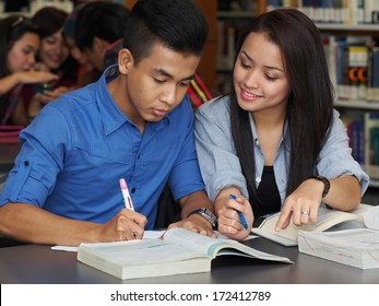 Student having discussion in college library