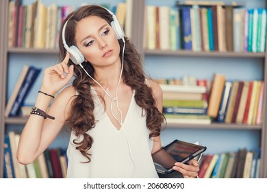 Student with headphones in library