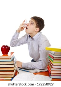 Student with Inhaler at the School Desk on the White Background